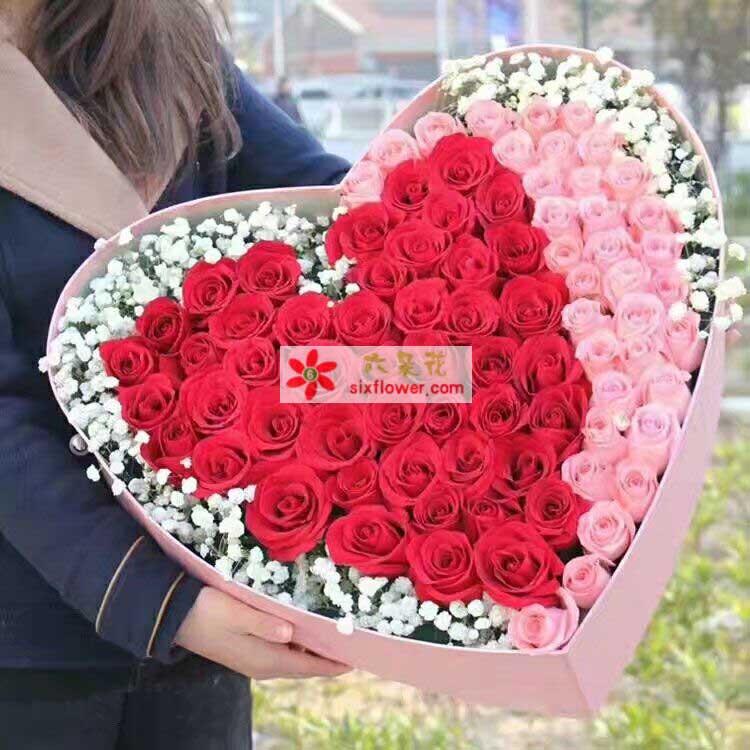 35枝粉色玫瑰,64枝红色玫瑰,周围满天星点缀;