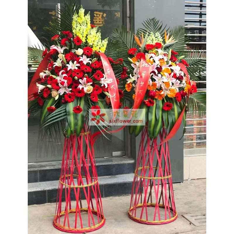 红色扶朗若干,10朵百合花,6枝香槟,洋兰,散尾葵,巴西叶搭配