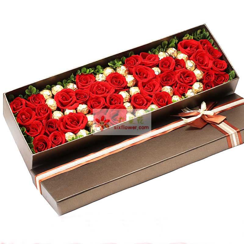费列罗巧克力31颗,39枝红玫瑰,其中巧克力摆成520字样,黄莺或者绿叶点缀