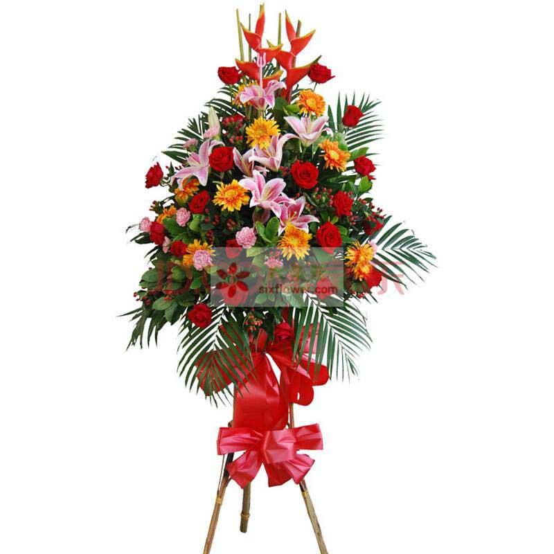 8朵粉色百合,18朵红玫瑰,8朵粉色康乃馨,9朵黄色扶郎花,2只富贵鸟,红豆、散尾葵搭配;